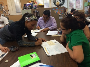 This is an image of UCF student, Christie with HCC student, Deña working on learning about the cabinets of government. You can see HCC student Marco in the photo as well.